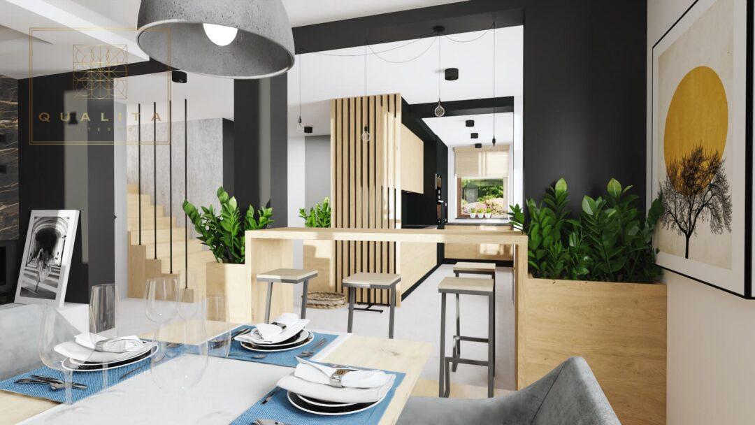 Qualita Interno nowoczesna otwarta kuchnia zabudowana barkiem połączona z salonem z kominkiem i jadalnią